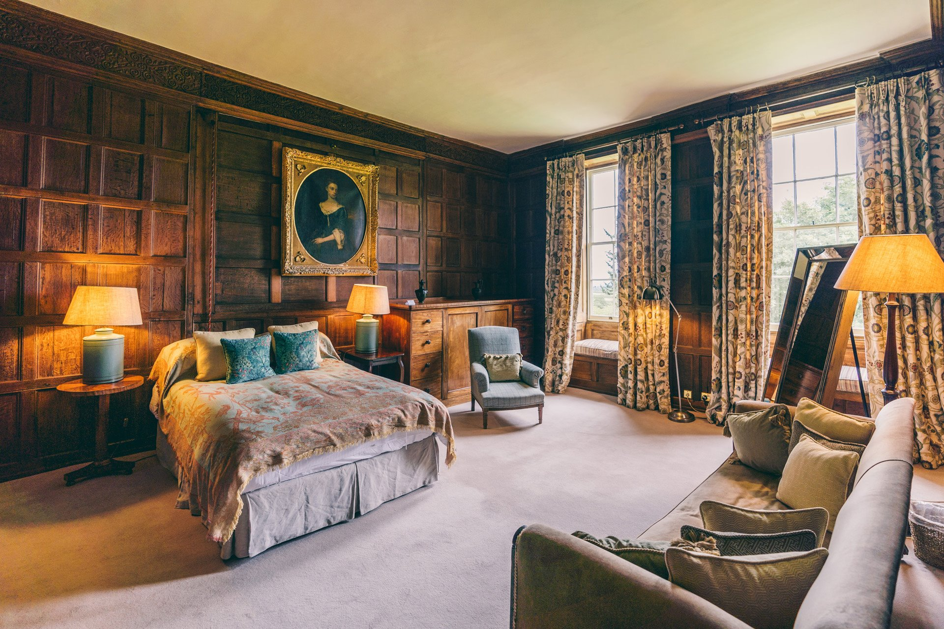 master suite dressing room beautiful wood panelled bedroom with double bed at wedding venue elmore court