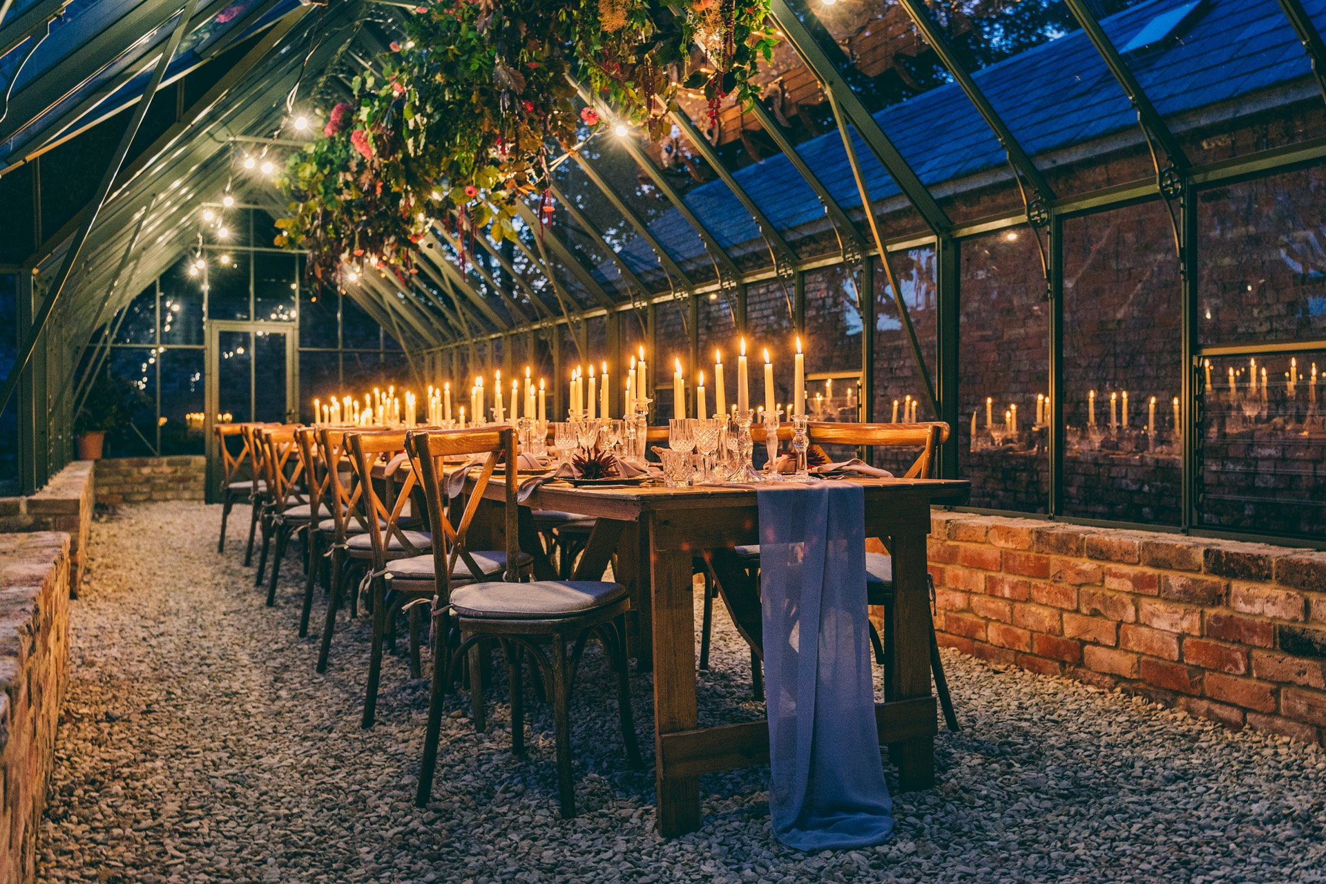 A candlelit dinner in a glasshouse, wedding inspiration by Elmore Court