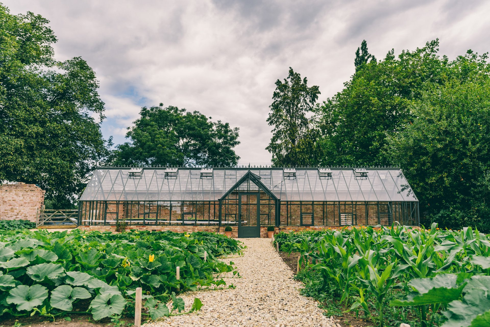 The green house in the walled garden at sustainable wedding venue elmore court