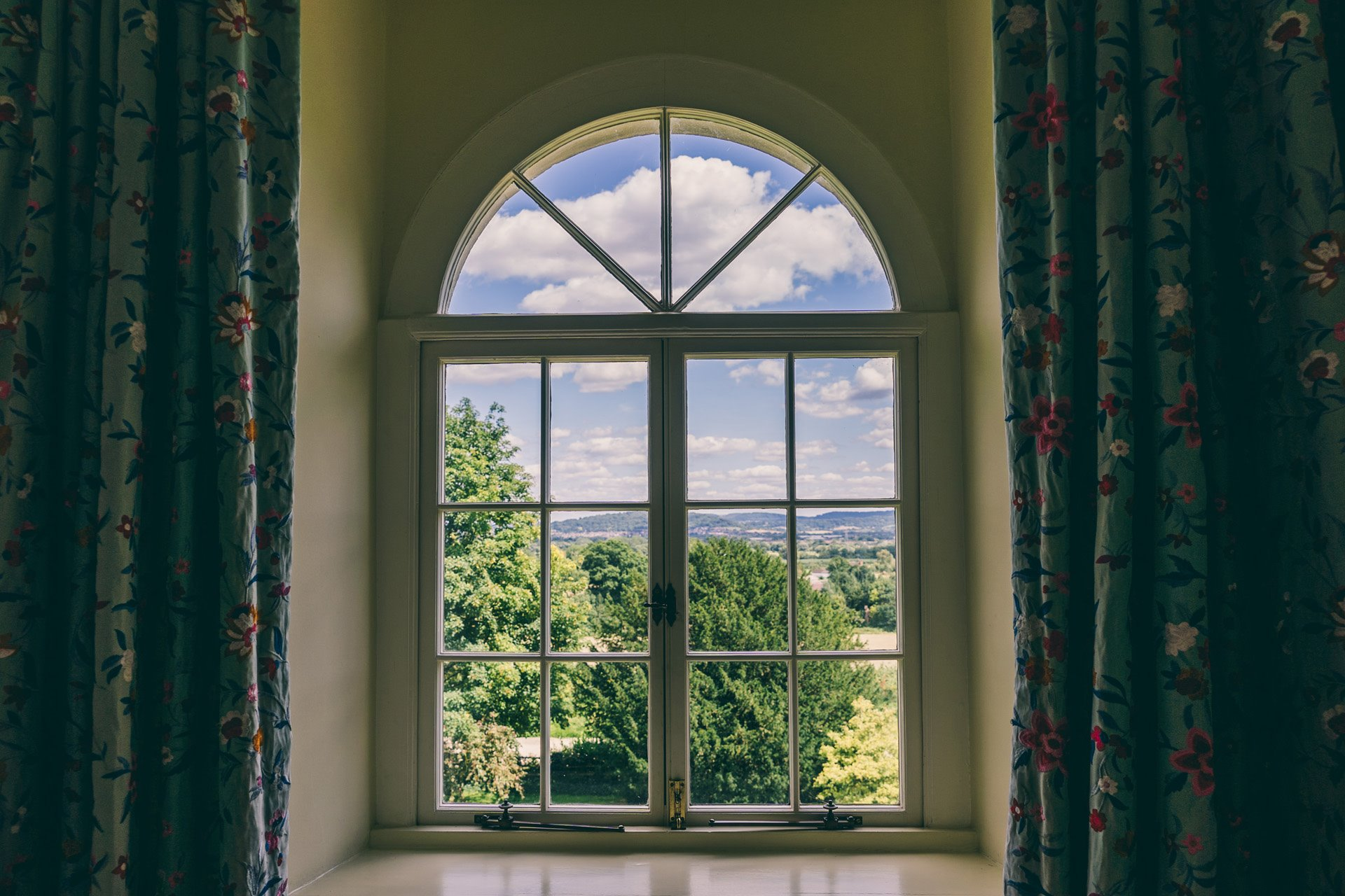 View of the cotswolds countryside from the window of the Time bedroom at wedding venue elmore court