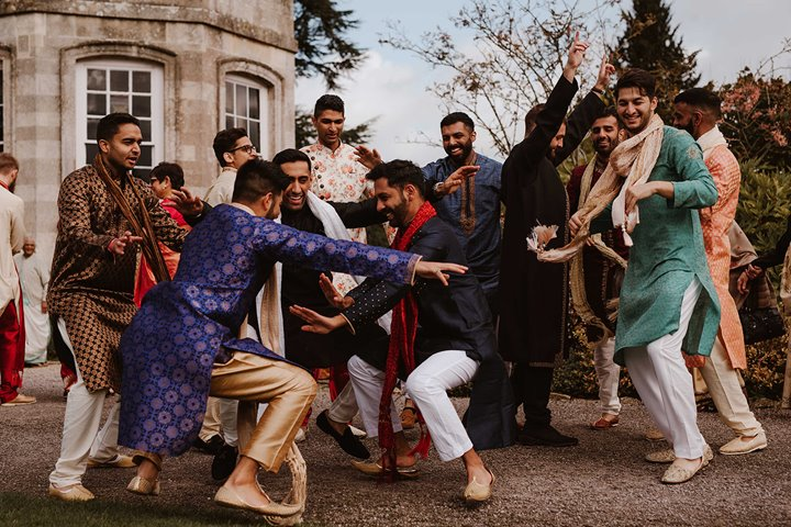 Dancing baraat party at indian wedding venue in the cotswolds