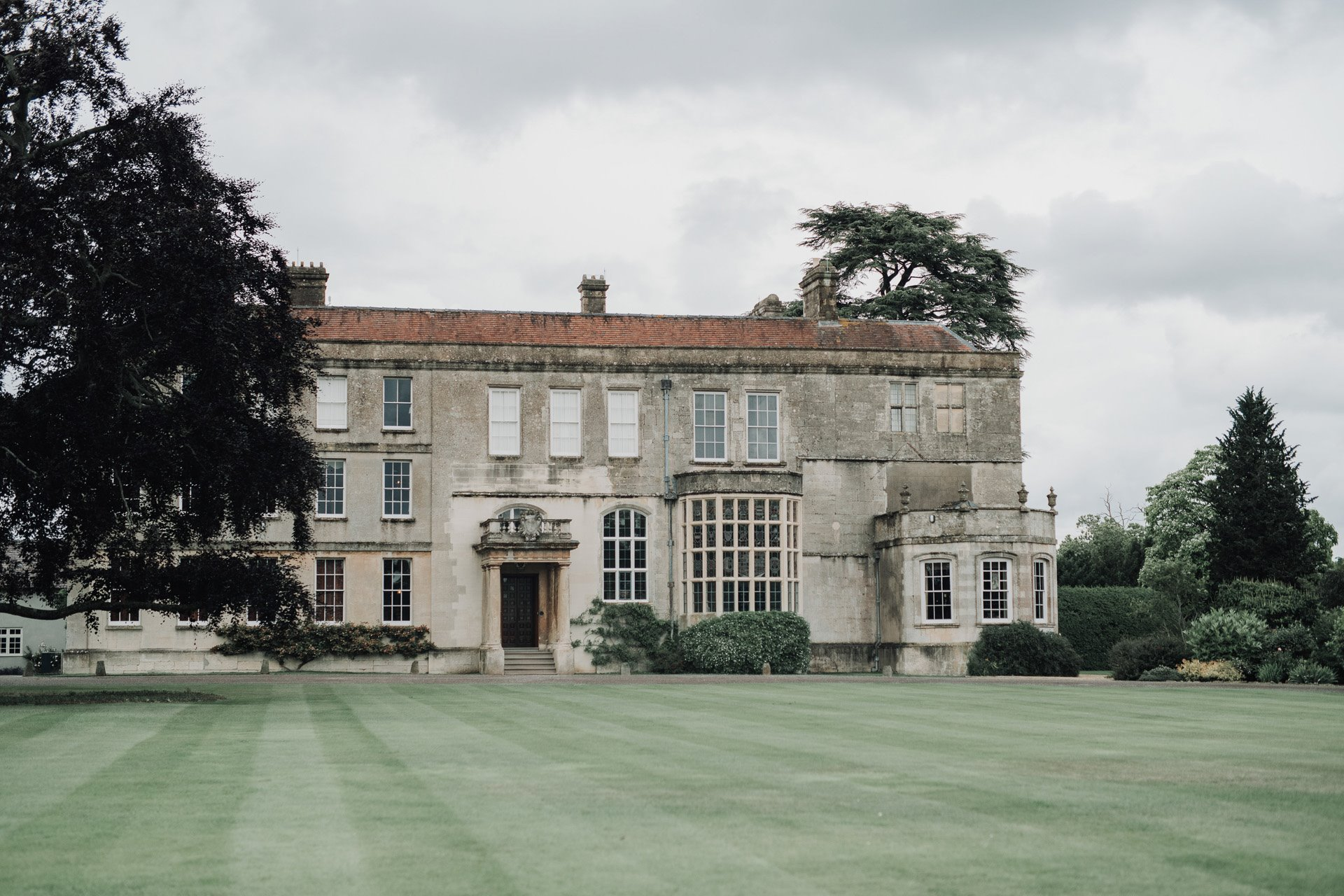 Stately home wedding venue elmore court with lawn and copper beech tree