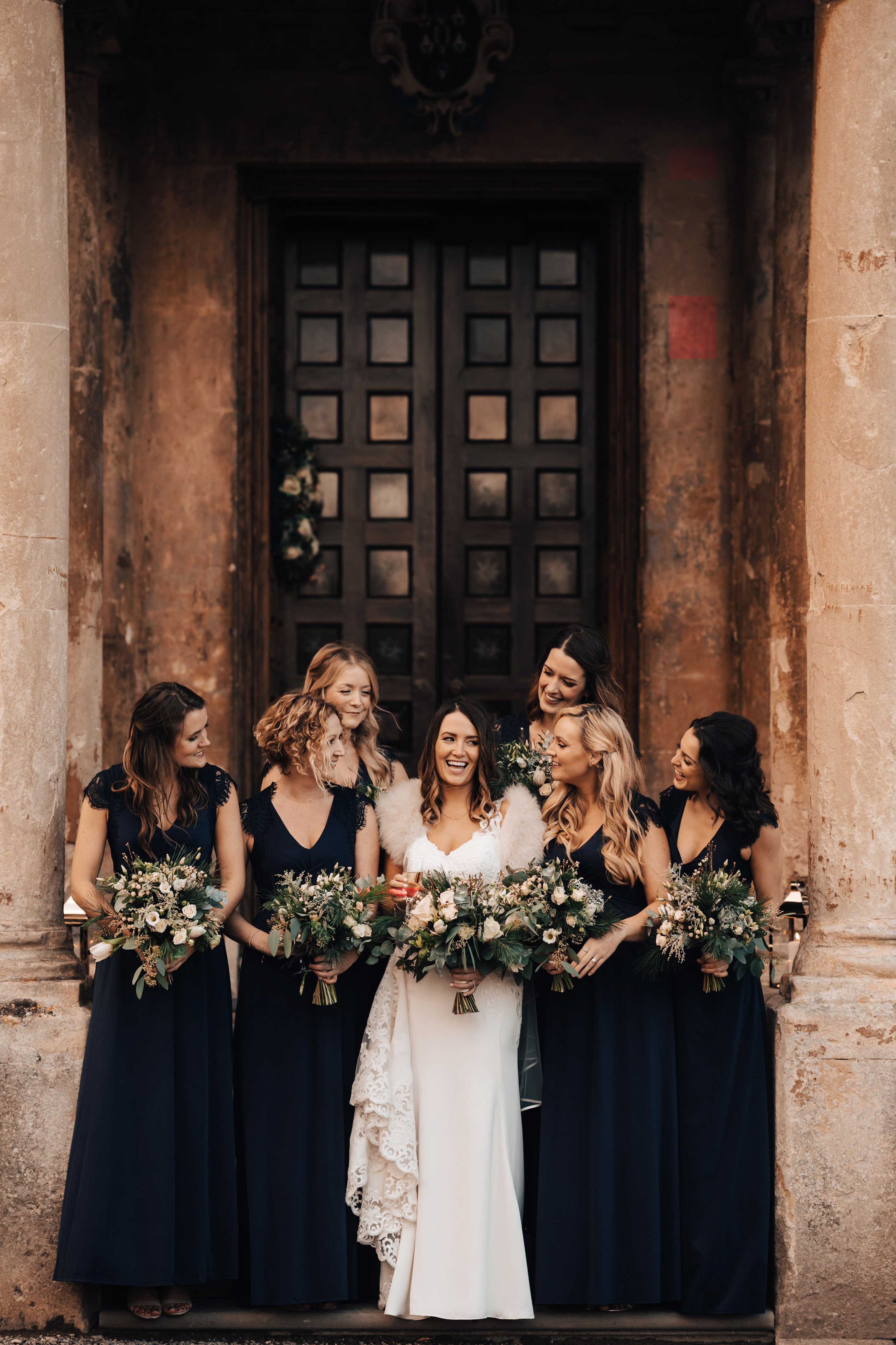Black bridesmaids dresses at an autumn wedding at elmore court