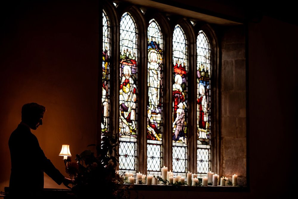 Candlelit church wedding with stained glass windows at Elmore church