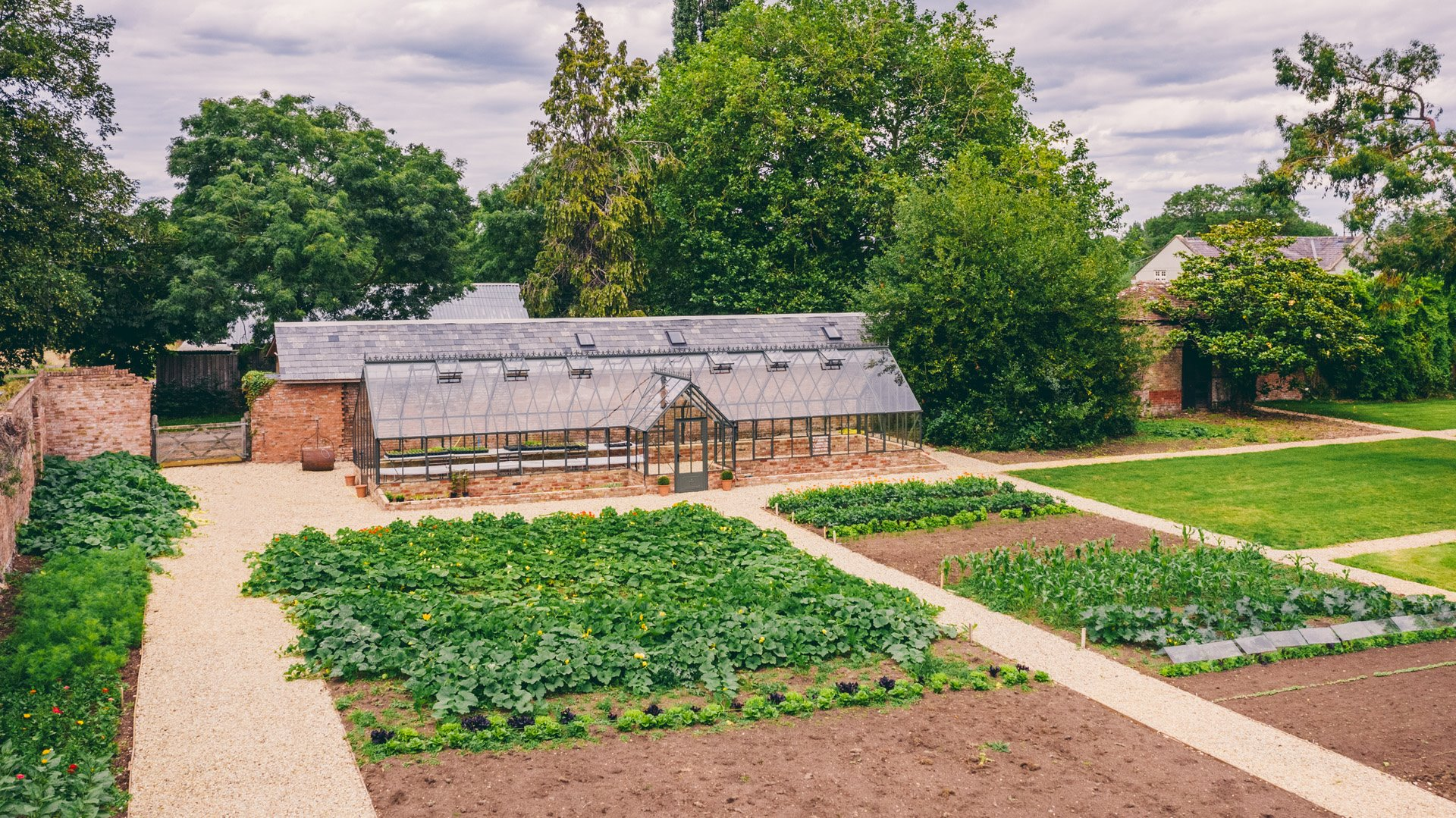 Walled garden and glass house from above. All events at elmore court include home grown food