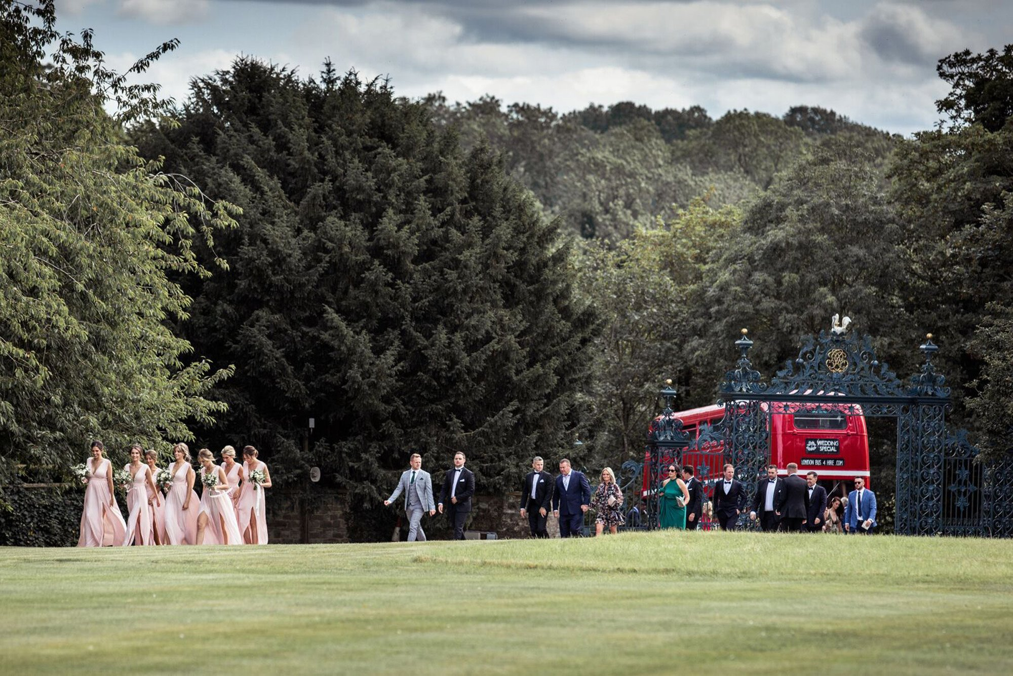 Bridal party get off an Old Double decker bus at the gates of Elmore Court