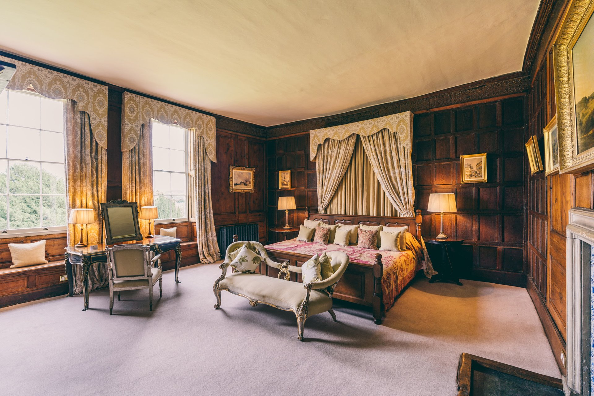 Bridal suite or guest accommodation the master suite at Elmore Court is a beautiful wood panelled room with giant caesar bed and adjoining dressing room