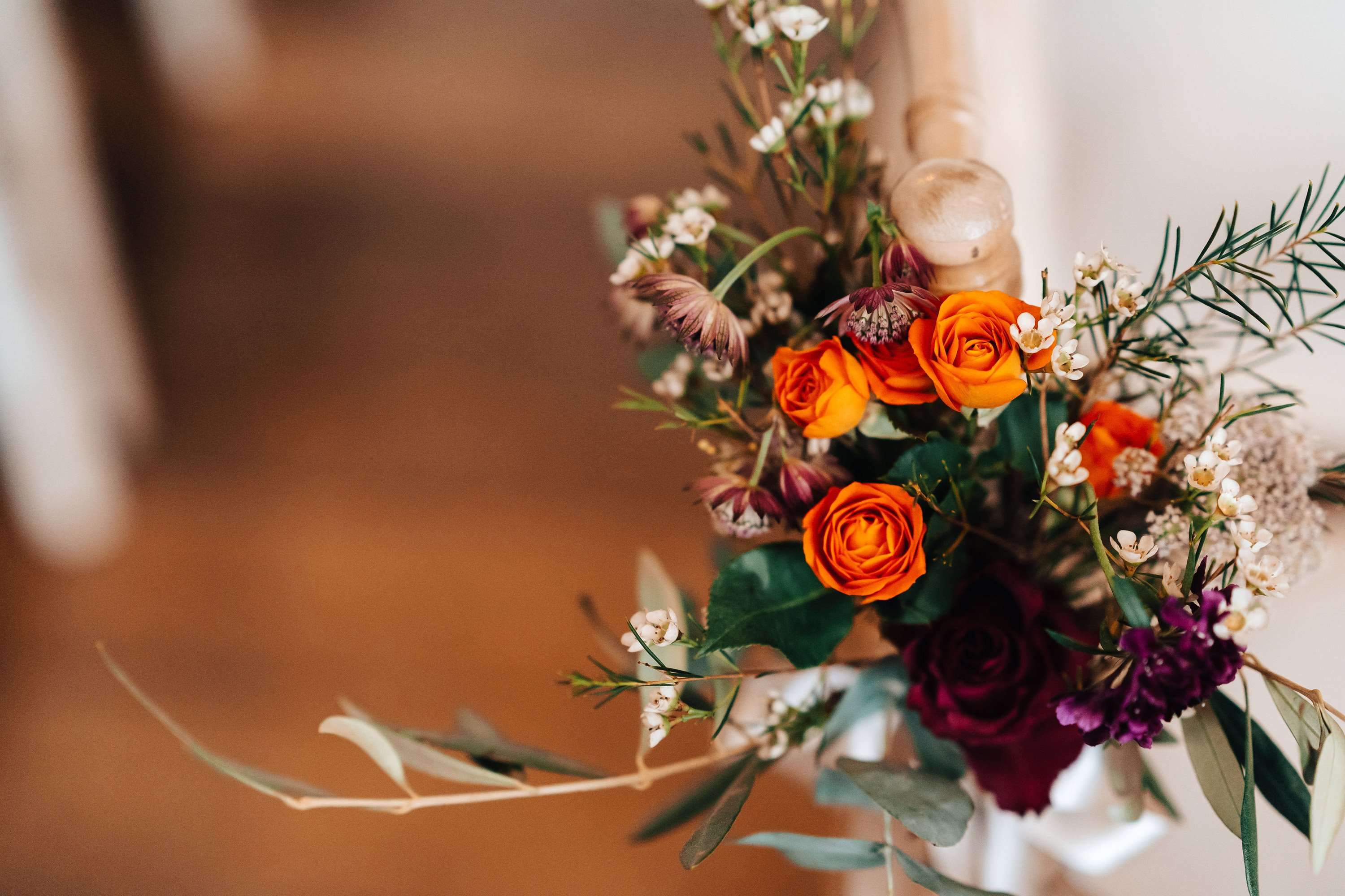Autumn wedding bouquet with orange roses