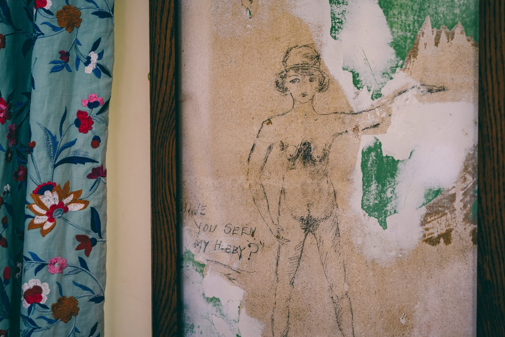 Ancient graffiti of a nude woman found in one of the bedrooms underneath the wallpaper of a stately home wedding venue