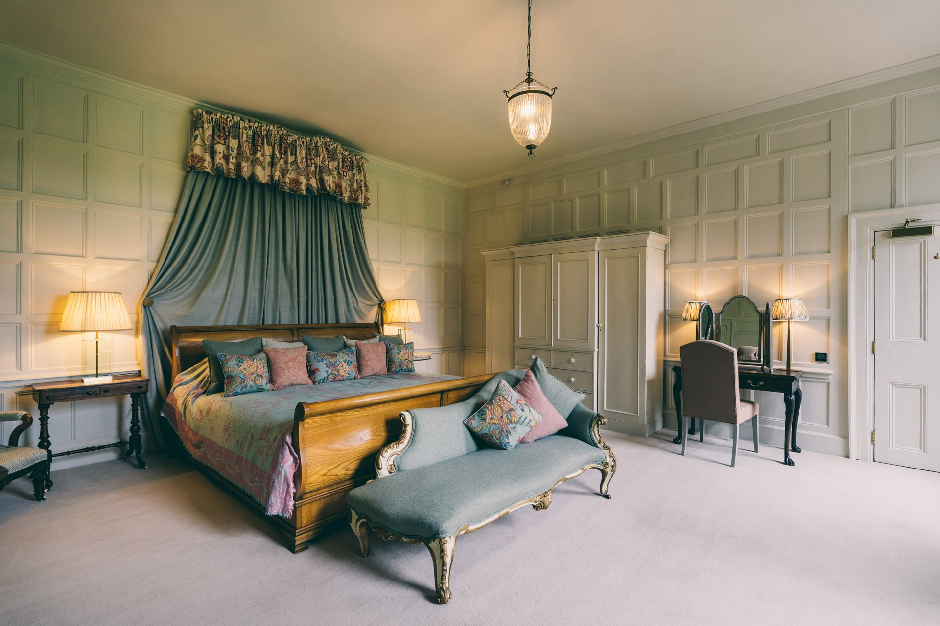 The smoking room white painted panelled room full of light with huge emperor bed could be your bridal suite or guest accommodation